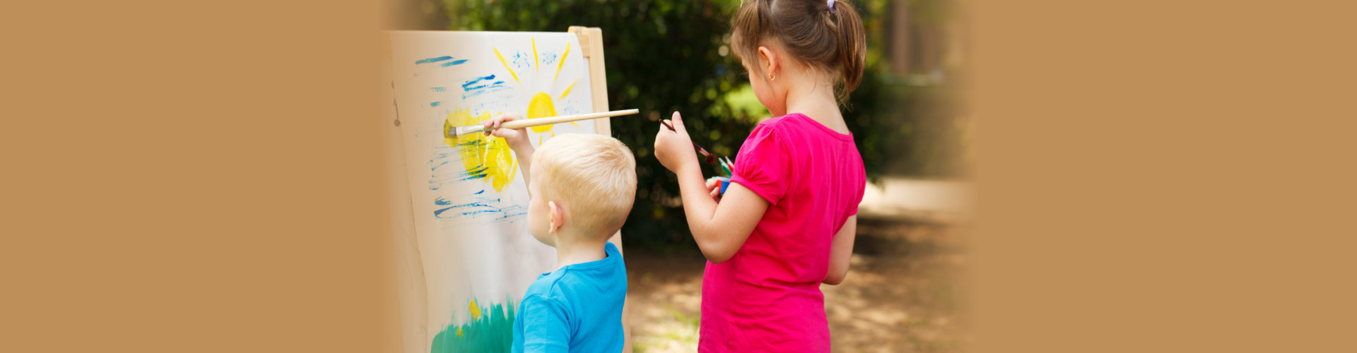 Pre-school children painting at the park